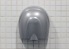 Hand Dryer. Electric wall mounted hand dryer stock images
