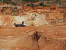 Hand dug quarry. Massive quarry near Banfora Burkina Faso was hand dug by natives. Native workers still hand excavate into trucks stock photos