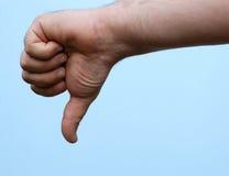 Hand: duim neer royalty-vrije stock afbeelding