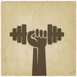 Hand with dumbbell. fitness symbol on old Royalty Free Stock Photography