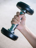 Hand with dumbbell Stock Photos