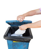 Hand dumping a foam of garbage Royalty Free Stock Photography