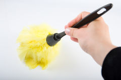 Hand with duster Royalty Free Stock Photos