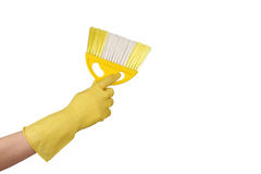 Hand with dustpan and brush. On white Royalty Free Stock Image