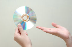 Hand and dvd. Passing the technology Stock Photos
