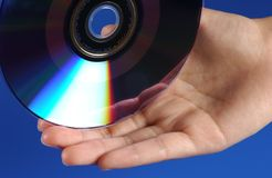 Hand DVD Stockfotografie