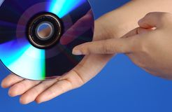 Hand and DVD. Two hand and a DVD royalty free stock photography