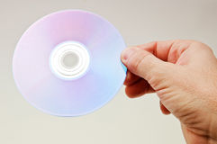 Hand with a dvd disc Stock Photography