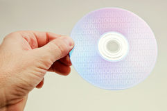 Hand with a dvd disc Stock Image