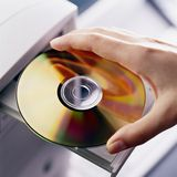 Hand with DVD disk Royalty Free Stock Image