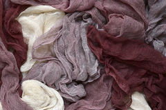 Hand dyed pastel colored gauze fabric in brown . royalty free stock images