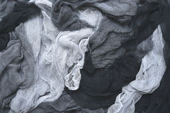 Hand dyed pastel colored gauze fabric in gray . Stock Photos
