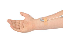 Hand with earphones like medical IV infusion Stock Photos