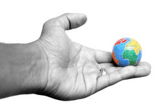 Hand and Earth Royalty Free Stock Photos