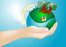 Hand and earth Royalty Free Stock Image