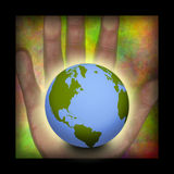 Hand and Earth composition Royalty Free Stock Image
