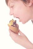 Hand eating chocolate ice cream Stock Photos