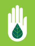 Hand With Ecology on Green Royalty Free Stock Images