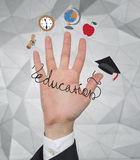 Hand with education icons Stock Photo