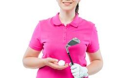 Hand eines Frauengolfspielers mit Ausrüstungsabschluß oben auf Weiß stockfotos