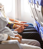 Hand of an elderly lady in the aircraft Royalty Free Stock Photos