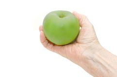 Hand of the elderly lady holding an apple Royalty Free Stock Photos