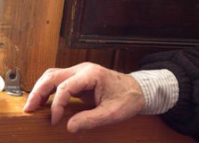 The hand of an elderly man. Lying on a wooden table Stock Image
