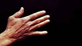 Hand of elderly black person Stock Image