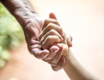 Hand of an elderly woman holding a child`s hand royalty free stock photography
