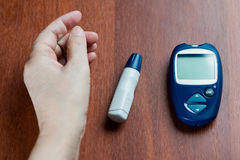 The hand of the elderly woman lies near the device for measureme. Nt of level of sugar in blood Stock Photography