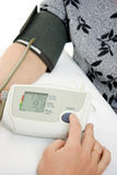 Hand an elderly woman with a sphygmomanometer Stock Photography