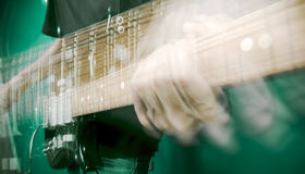 Hand and electric guitar Royalty Free Stock Image