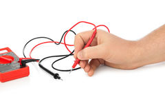 Hand and electric multimeter Stock Image