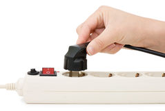 Hand with an electric plug and socket Royalty Free Stock Image