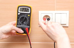 Hand electrician checking voltage Royalty Free Stock Image