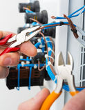 Hand of an electrician royalty free stock photo