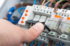 Turning on a fusebox Stock Photography