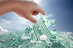 Hand and electronic jigsaw pattern. Stock Images