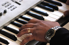 Hand on electronic organ Royalty Free Stock Photography