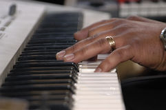 Hand on electronic organ Royalty Free Stock Images