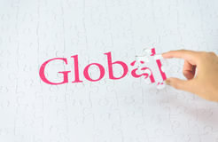 Hand embed missing a piece of Global word Stock Image