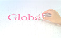Hand embed missing a piece of Global word Stock Photography