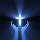 Hand embrace god cross light flare Stock Photography