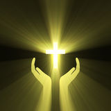 Hand embrace god cross light flare Royalty Free Stock Photos