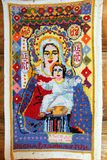Hand embroidered icon of the Mother of God by unknown craftsman - sample of Russian folk art in a small rural church. DMITROVSK, RUSSIA - AUG 27, 2014: Hand royalty free stock image