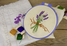 Hand embroidering on linen on the table Stock Image