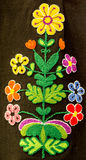 Hand embroidery in the form of colorful flowers on a woman`s skirt. Traditional crafts of Bulgaria Royalty Free Stock Photography