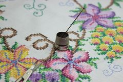 Hand embroidery with needle and scissors royalty free stock image