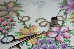 Hand embroidery with needle and scissors stock photos