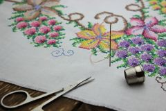 Hand embroidery with needle and scissors royalty free stock photography